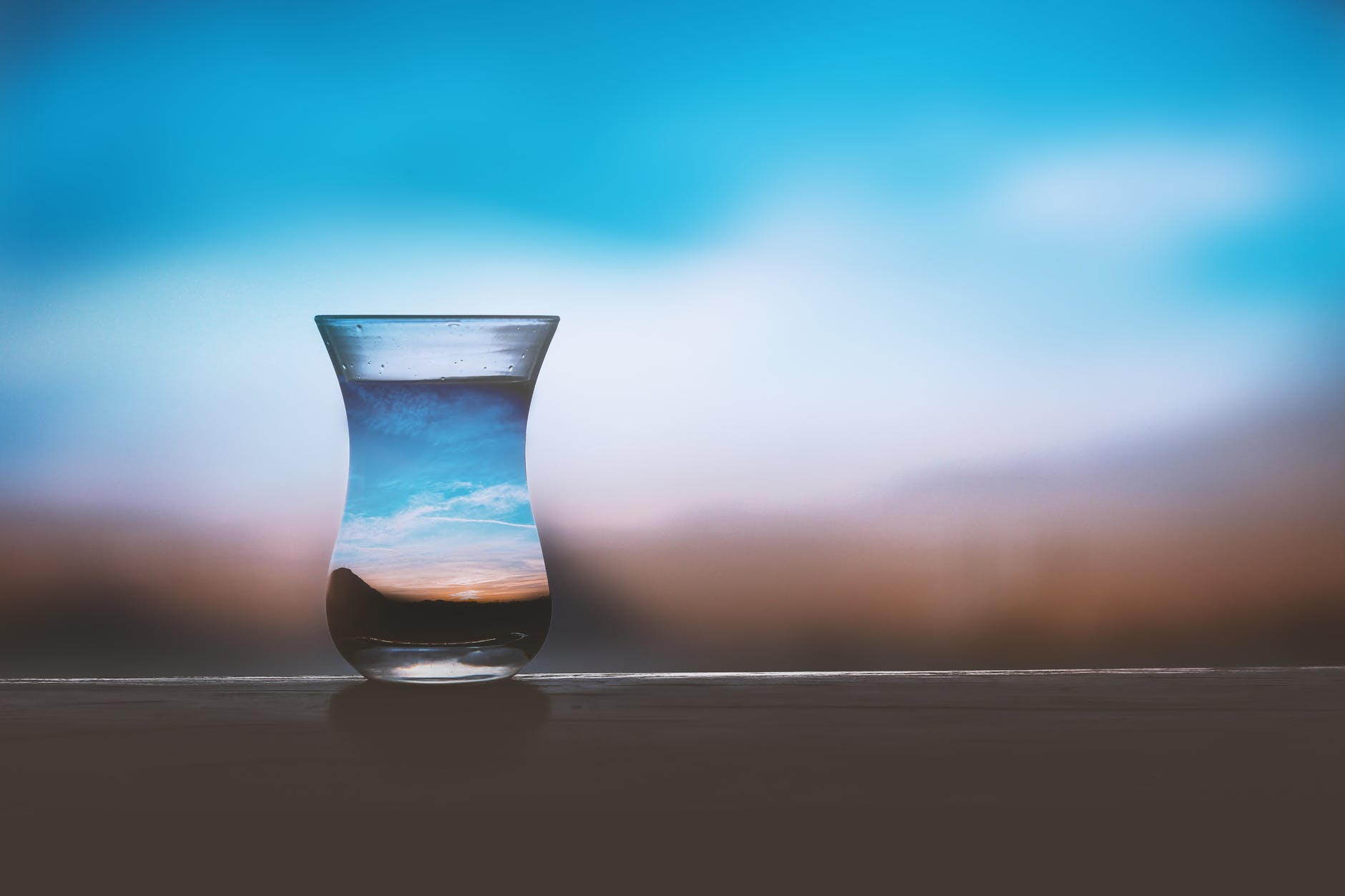 white and brown ceramic vase