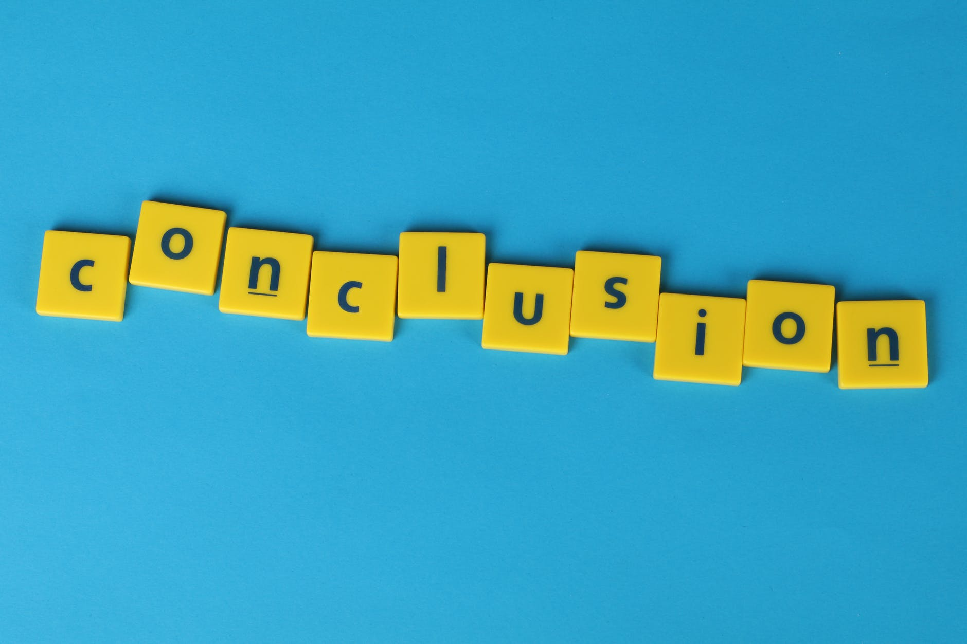 conclusion word formed from lettered yellow tiles